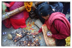 Lighting a candle (posterboy2007) Tags: kathmandu nepal hindu festival candle woman