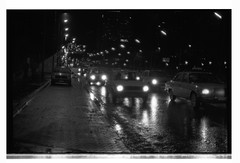 Nuit 4 (godelieve b) Tags: brussels bruxelles noiretblanc blackwhite argentique street urban ville nuit night voitures cars boulevard pluie rain trafic circulation eighties 1985