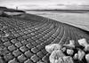 The coast (Duevel) Tags: dijk dike patterns rocks zeeland water bw coast tamron28300