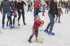 Helping a Penguin to skate (Frank Fullard) Tags: frankfullard fullard help ice skate iceskating candid street portrait girl little penguin castlebar mayo irish ireland fun lol happy enjoyment red sport funny