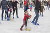 Helping a Penguin to skate (Frank Fullard) Tags: frankfullard fullard help ice skate iceskating candid street portrait girl little penguin castlebar mayo irish ireland fun lol happy enjoyment red sport funny