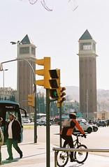 Traffic. Plaça d'Espanya, Barcelona, November 17 (arsenterzyan) Tags: cityscape portra portra160 kodak eos3 canon analog grain 35mm film zebra city day sun trafficlight bicycle cars people travel barcelona spain square traffic street
