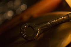 Keylight (tiki.thing) Tags: macromonday macro key tealights bokeh light litbycandlelight gong 7dwf 7daysofshooting week24 anythinggoes golden candle orange metal rust worn