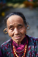 Gurung  old woman, Chomrong, Annapurna massif, Nepal (Alex_Saurel) Tags: asia culture portray tradition colliernépalais photoreport posing asian boucledoreille day annapurnabasecamptrek reportage earring travel 35mmprint portraiture grosplan gurung people nepal traditional photospecs eyes greyhair necklace portrait wrinkle cheveuxgris abctrek imagetype wrinkles portraitserré closeup gurungnecklace lifestyles asie photojournalism lobering oldwoman scans stockcategories pose rides nepalinecklace annapurnaconservationarea time photoreportage sony50mmf14sal50f14