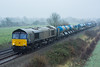 66426 Thurston 20/12/17 - Filthy weather for a filthy train. 66426 hauls away the Stowmarket based RHTT wagons as another RHTT season passes by. 66421 brings up the rear of the train. (rhayward92) Tags: 66426 drs direct rail services rhtt head treatment train class 66