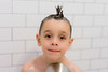 Channelling his inner Bueller (Craig's Collection) Tags: sony a7ii a7m2 55mm18 portrait boy mohawk shower fun shampoo