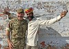 BRITISH AND INDIAN TROOPS SHARE EXPERIENCES AND DEEPEN PARTNERSHIP (Defence Images) Tags: exerciseajeyawarrior humour moustache fun india local defence defense uk british military