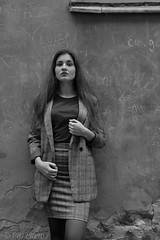 Girl and a wall (piotr_szymanek) Tags: marcelina portrait outdoor decay blackandwhite woman skirt wall oldtown longhair young fashion 5k 10k 50f mini 20k hand 1k 20f 30k marcelinab