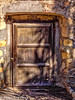 Old Door (lorinleecary) Tags: california doors santabarbara stone brown padlock woodendoor