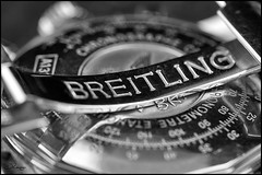 It's All In The Detail (Donna Rowley) Tags: macromonday madeofmetal breitling navitimer watch chronograph wrist jewellery jewellers time name strap metal silver shine blackandwhite bw macro detail focus dof canon underneath underside engraved