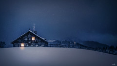 Allgäuer winter nights (VandenBerge Photography (On/off ....but mostly off) Tags: ofterschwangerhorn alps winter snowscape sky season snow farmhouse lights nature night germany allgäu gunzesried snowing chimney forest fence canon europe mountains