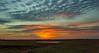 Setting Sun Over Pond (thefisch1) Tags: sunset pond horizon sky alto cumulus kansas pasture blurred