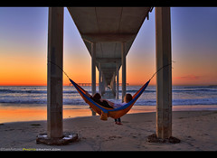 Hanging around for another joyful San Diego sunset! (Sam Antonio Photography) Tags: oceanbeach sandiego couple hammock two love sunset pier ocean beach water sea california landscape dusk sand evening outdoor pacific reflection travel exposure under architecture structure nature serene perspective coast landmark beneath scenic concrete shoreline underneath romantic dreaming samantoniophotography