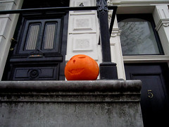 Trick or treat (Valantis Antoniades) Tags: netherlands netherland amsterdam holland dutch lower countries architecture selective colour color halloween trick or treat pumpkin orange