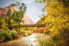 Zion Footbridge - Textured (byron bauer) Tags: byronbauer zion nationalpark virgin river valley canyon sandstone rock cliff trail utah sky clouds vista landscape water stream trees colors texture topaz simplify impression rust steel bridge span painterly rocks redrock riverbank tree