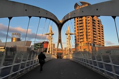 Salford Quays to Trafford Wharf 18-metre-lift footbridge - Greater Manchester, England. (edk7) Tags: olympusomdem5 edk7 2017 uk england greatermanchester metropolitanboroughoftrafford thequays manchesterm17 manchestershipcanal salfordquaysliftbridge salfordquaysmillenniumfootbridge lowrybridge 912metrelong verticalliftbridge salford trafford 2000 salfordquays mediacityuk traffordwharf bridge tower architecture building structure modernist residential commercial city cityscape urban sunset metal 18metrelift