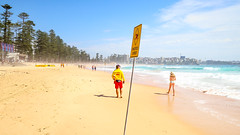 Washed away (geemuses) Tags: manlybeach nsw australia manly sun surf sand beach northernbeaches water sea salt lifeguard girl woman bikini landscape seascape color colours yellow blue red