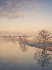 Between River And Mist (Captain Nikon) Tags: sawley rivertrent river derbyshire leicestershire allsaintschurch misty mist trees reflections pastels winter atmospheric moody nikon18105mm nikond7100