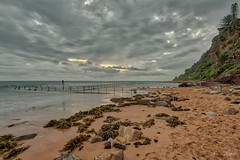 That sky doesn't look too good (JustAddVignette) Tags: australia clouds dawn firstlight hightide landscapes newsouthwales newport northernbeaches ocean rocks seascape seawater sky sydney water