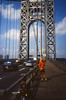 Self on the George Washington Bridge north side - Ektachrome - 1996 (Ron of the Desert) Tags: film slidefilm positivefilm reversalfilm e6 ektachrome kodak georgewashingtonbridge gwbridge bridge bicycle self redtshirt newyorkcity hudsonriver newyork epsonperfectionv600
