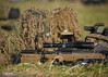British Army Sniper Commanders Course (Defence Images) Tags: 525x56mm scope telescopicsight smallarms boltaction spottingscope sniper weapon camo sws specialistweaponschool warminster livefiring 338mm 338 sniperrifle rifle l115a3 l115a2 specialist snipercourse ghilliesuit ghillie army equipment clothing combats camouflage multiterrainpattern mtp aiming firing weapons gun firearm l115a3longrangerifle 859mm ammunition rounds personnel nonidentifiable soldier male man training terrain landscape grassland wooded woods defence free defense uk british military wiltshire england