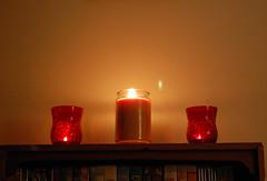Candle Trio. (dccradio) Tags: lumberton nc northcarolina robesoncounty indoors inside candle candles burning illuminated flame redcandleholder candleholder tealightcandle jarcandle wall fire nikon d40 dslr tealight red light candlelight