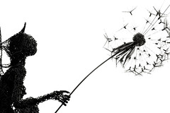 Fairy blowing a dandylion Black and white  White space (Matt Burke) Tags: white space fairy sculpture wire dandylion blow naked art