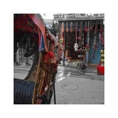 Looking past the tattered roof of a rickshaw (posterboy2007) Tags: kathmandu nepal rickshaw roof tattered sreet shop red sony colour splash