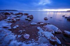 Ice Caps (tinamar789) Tags: ice icy rocks sea seashore seascape sunset snow sky winter water blue landscape light frost frozen cold lauttasaari helsinki finland freezing horizon seaside serene