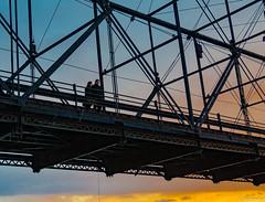 Couple on the Bridge (charlie_guttendorf) Tags: bridge guttendorf harrisburg nikon nikon18200mm nikond7000 susquehannariver uncoveringpa centralpa couple goldenhour outdoorphotography outdoors outside peple susquehanna winter