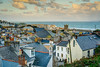 The Rooftops of St Ives - Cornwall. (john lunt) Tags: cornish english seaside town st ives cornwall rooftops roof chimneys attic windows buildings church steeple lighthouse coast coastal harbor harbour beach sea water sand holiday vacation destination tourism tourist spot colour color southwest england uk britain beautiful scenic horizontal landscape picturesque architecture john lunt johnlunt sony a7r ii zeiss 55mm f18 za prime lens
