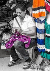 Hand-crocheted clothing (FotoGrazio) Tags: filipina philippines selectivecolor streetphotography waynegrazio waynesgrazio woman clothing crochet exisitingight fotograzio handmade knitting people sidewalkbusiness sidewalkvendor street streetportrait streetscene vendor