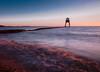 Dovercourt Dawn (selvagedavid38) Tags: dovercourt lighthouse essex harwich beach shore waves tide dawn