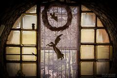 Mystery Castle (PhotoArtMarie) Tags: phoenix mysterycastle landmark round window glass figurines wreath