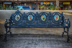 Bench at Taos Plaza (donnieking1811) Tags: newmexico taos bench taosplaza wroughtironbench paintings park outdoors hdr canon 60d lightroom photomatixpro