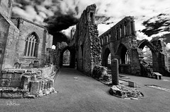 Elgin Cathedral (Tom McPherson) Tags: cathedral church elgin scotland decay abandoned castle building stone in explore trending blackwhite black white mono today seasonal cold landscape bleak dismal december winter tag nikon 1635 angle high tall architecture dark gritty unsettling gothic challenging eye eyesore urban exploration rural digital processed trust film seascape colour classic classical towering tower huge large life wild clouds sky f8 16mm creative artwork art magazine local north east tom mcpherson hopeman camera iso exposure metering spot matrix