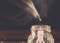 Auld Lang Syne (Fire Fighter's Wife) Tags: music song inspiredbymusic redux2017 redux2017myfavoritethemeoftheyear light lighting wick birthdaycandle nikond750 nikon closeup 40mm moody dark january 2018 oldintonew smoke flame candle macromonday's happynewyear happymacromonday macro inspiredbysong memberschoiceinspiredbysong hmm