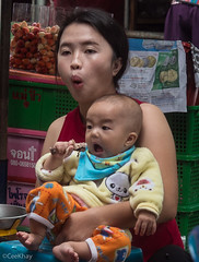 baby chewing chicken (Never.Stop.Searching.) Tags: chiangmai photography thailand people streetscenes market
