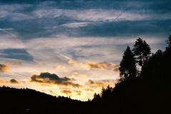 Schwarzwald sunrise (film) (mkk707) Tags: film 35mmfilm leicaflexsl2 summicronr50mm kodakektar100 wwwmeinfilmlabde clouds sunrise silhouette vintagelens vintagefilmcamera germancameras dawn schwarzwald schönmünzach blackforest elucefu