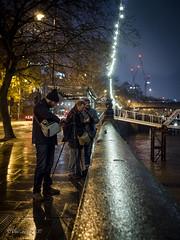 Photographers Interupted (amipal) Tags: 175mm capital city england gb greatbritain london lowlight manuallens night rain river thames uk unitedkingdom urban voigtlander wet