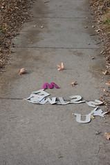 (J.G. Park) Tags: 2017 columbia sidewalk missouri trash letters 50mm prime primelens
