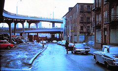 More New York fun in the good old days! Before the South Street Seaport and gentrification, the Lower East Side was a total dumping ground filled with abandoned 19th Century brick buildings which once housed stores and tenants. New York 1970 (wavz13) Tags: oldphotographs oldphotos 1970sphotographs 1970sphotos oldphotography 1970sphotography newyorkphotographs newyorkphotos oldnewyorkphotography oldnewyorkphotos vintagenewyork vintagemanhattan vintagenewyorkphotography vintagenewyorkphotographs vintagenewyorkphotos oldbuildings abandonedbuildings vintagebuildings 19thcenturybuildings lowereastside depressing bleak noir noire dark abandonedstores manhattanskyline newyorkskyline 1970smanhattan 1970snewyork oldnewyork oldmanhattan newyorkskyscapers 1970scars 1970scar oldcars oldcar 1960scars gloomy urban grain grainy urbanwasteland eastriver southstreet