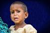 Don't fear the New Year! (Pejasar) Tags: boy child fear afraid art artistic bluebackground rural india sugarcanefarm