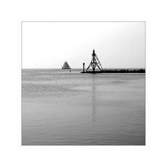 After You Left (YIP2) Tags: sailing sails sailboats masts sailingboats island harbor holland netherlands sea water landscape seascape beacon lighthouse bw boat