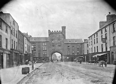 Castle or traffic obstruction - Clonmels dilemma? (National Library of Ireland on The Commons) Tags: eason easonson easoncollection easonphotographiccollection glassnegative 20thcentury nationallibraryofireland castle clonmel countytippperary towngate roadblock trafficobstruction people themainguard westgate gate crenellatedparapet tudorrevival oconnellstreetclonmel laurencesterne