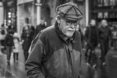 The Long Winter (Leanne Boulton) Tags: portrait urban street candid portraiture streetphotography candidstreetphotography candidportrait streetportrait streetlife old elderly man male face expression mood emotion feeling cap winter weather beard style fashion stylish tone texture detail depthoffield bokeh naturallight outdoor light shade shadow city scene human life living humanity society culture peoeple canon canon5d 5dmkiii 70mm ef2470mmf28liiusm black white blackwhite bw mono blackandwhite monochrome glasgow scotland uk