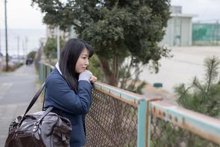 High school student girl waiting for boyfriend after school