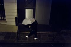 Day 316 - Hidden rushing man (cframezelle) Tags: basket book2017 hidden man night umbrella white paris city urban france pentax prime