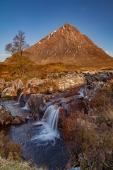 Buachaille Etive Mor and the River Coupall (Chris_Hoskins) Tags: wwwexpressionsofscotlandcom scottishlandscapephotography scotland waterfall glencoe scottishlandscape rivercoupall sunrise buachailleetivemor landscape