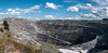 Panorama of the deep open stone pit at the noon (Denis Vahrushev) Tags: russia southernural ural altitude black blue break breakage bright brown calm cloud colossal day deep directlight driveway grand grandiose green grey height highcontrast hill industrial july landscape light midday mine mountain noon noonday noontime pit precipice road rock season stone strongcontrast structure summer sunlight satka chelyabinskayaoblast ru